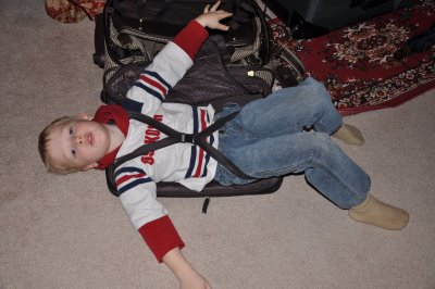 Boy Strapped into Suitcase