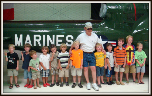 Children stand with pilot in front of helicopter at Northwest regional airport near dallas texas