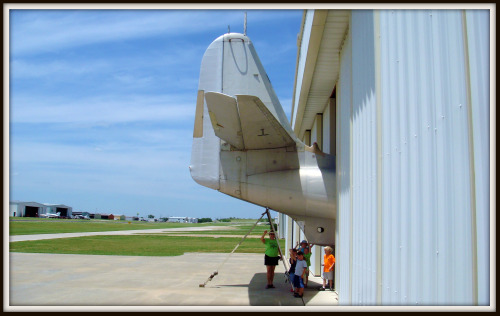 Amphibious aircraft tail out of hangar at Northwest Regional Airport in Dallas Texas
