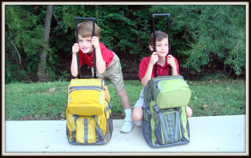 2 boys with backpacks on the first day of school