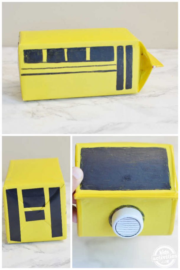 add details for the school bus mail box using black marker