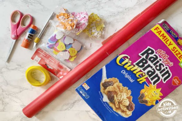 supplies for making a valentine's day box for school out of a cereal box