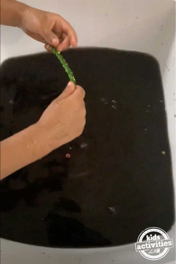 Black water in a tub for hide and seek tub activity using leftover east egg dye