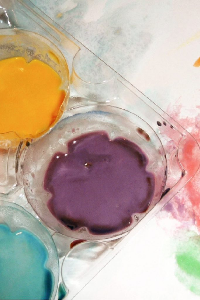 Finished homemade watercolor paint recipe for kids shown in an egg carton ready to paint