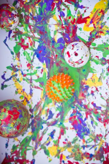 Ball art project for preschoolers - balls on paint on canvas
