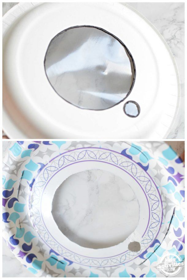Glue the plastic sheet on the inside of the paper plate