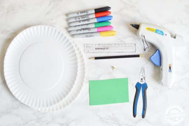 supplies for making diy clock using paper plates
