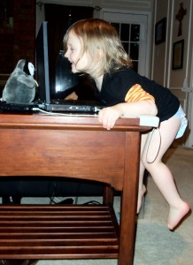 child climbing on table for laptop