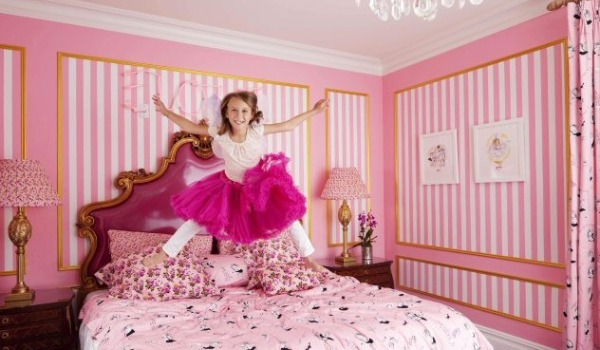 girl jumping on pink bed - eloise