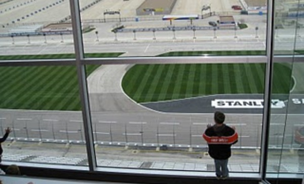 boy looking down at race track