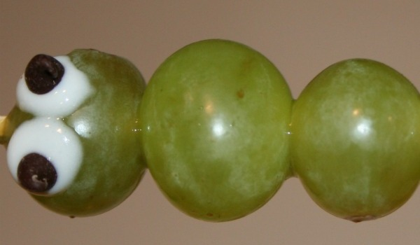 caterpillar treat made with grapes and icing