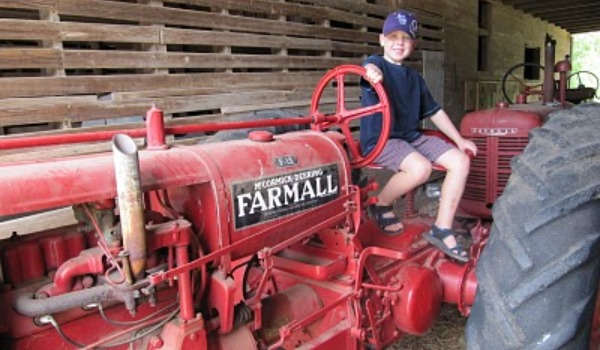 little boy on red tractor