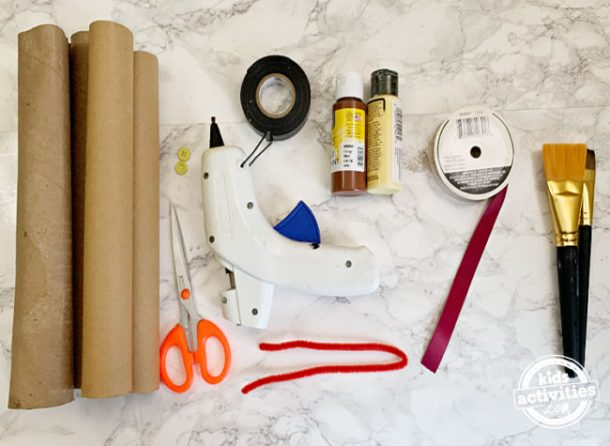 supplies for making toilet paper snake craft using empty toilet paper rolls