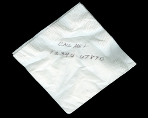 white napkin with phone number