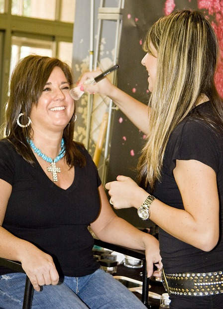 women getting blush on in makeover
