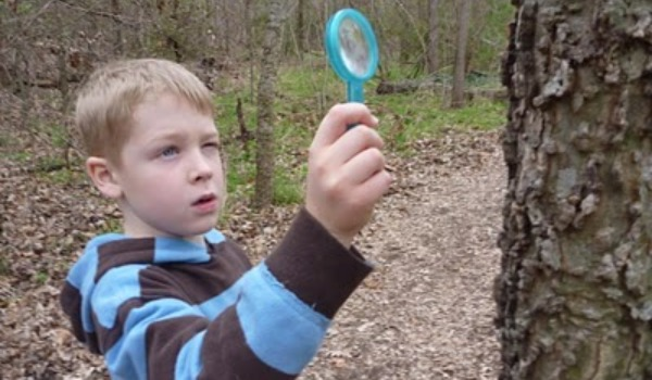 boy with magnifying glass 600x350