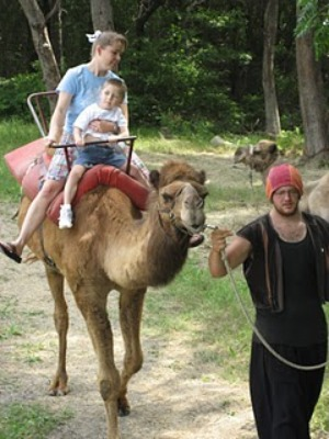 mom and boy on camel ride