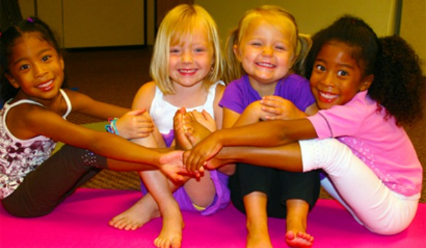 Four little girls smiling together 600x350