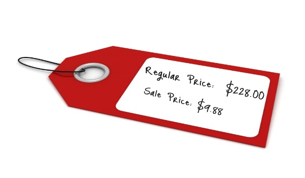 red sales tag with white center
