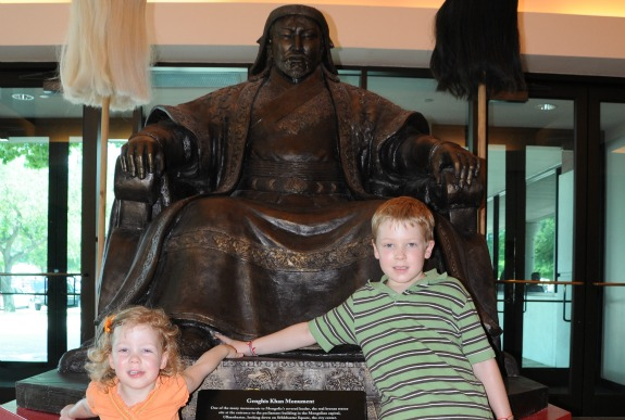 2 kids in front of Genghis Khan statue 575x387