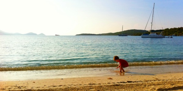 boy plays on St. Thomas beach - Great Bay
