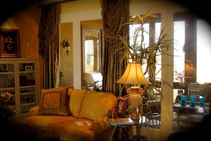 Ashlins interior with upscale sofa, curtains and chic lamp