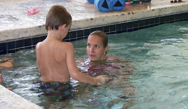 boy and woman in swimming pool