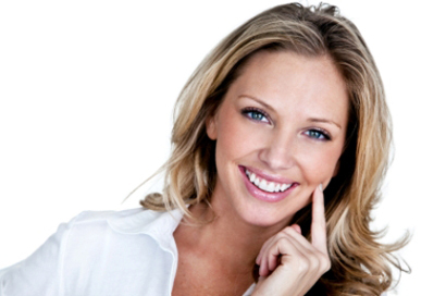 woman smiling in front of white backdrop