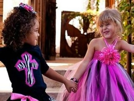 two little girls holding hands