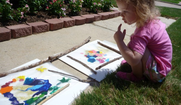 little girl outdoor art work