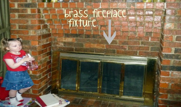 brick fireplace brass fixture