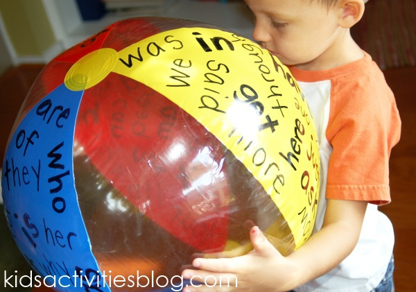 Sight Word activity Ball that has red, yellow, and, blue with various words written on it.