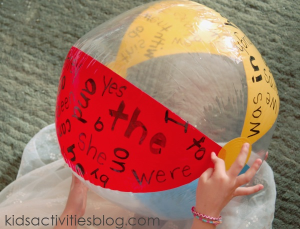 Sight Word activity Ball used for this sight word movement games with common used words on the red, blue, and yellow sections of the beach ball.