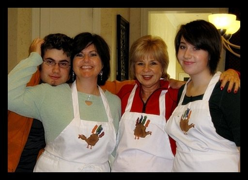 The whole family wearing the turkey aprons we made.