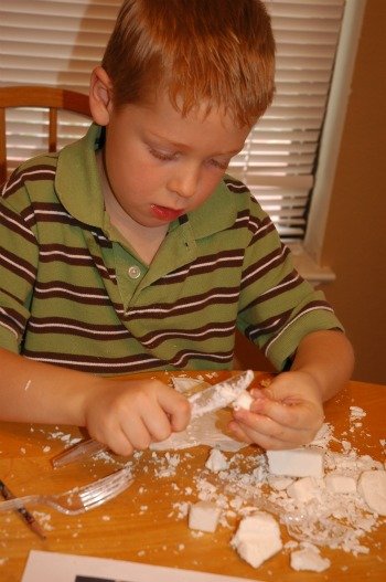 boy with soap carving shavings