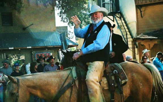 red steagall cowboy on horse