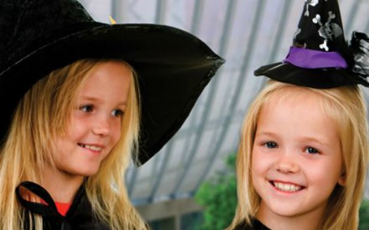 two little girls in witch hats