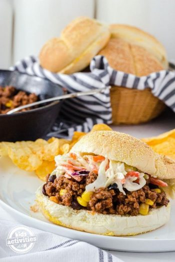 Chipotle Sloppy Joes from scratch with crunchy coleslaw topping on a white plate