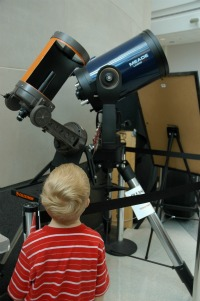 boy with telescopes