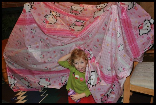 girl in homemade tent