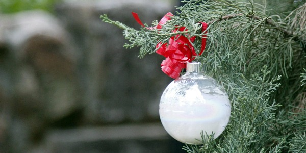 DIY painted Christmas ornaments with white paint to make it look like snow