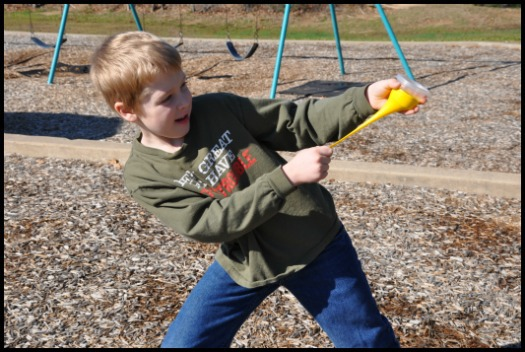 boy playing with marshmallow shooter