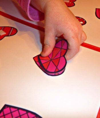 little hand working heart puzzle