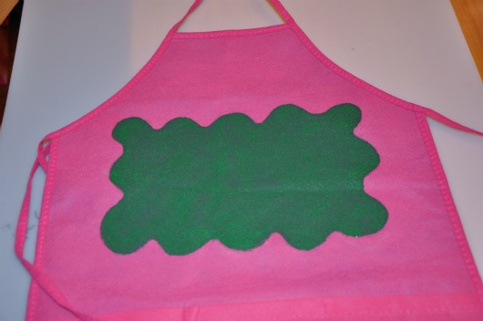 pink apron green splotch