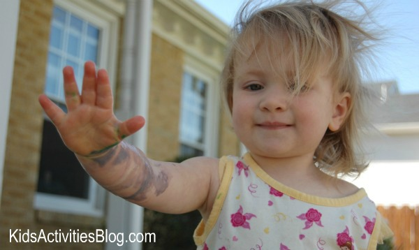 little-girl-with-paint-on-hand-and-arm