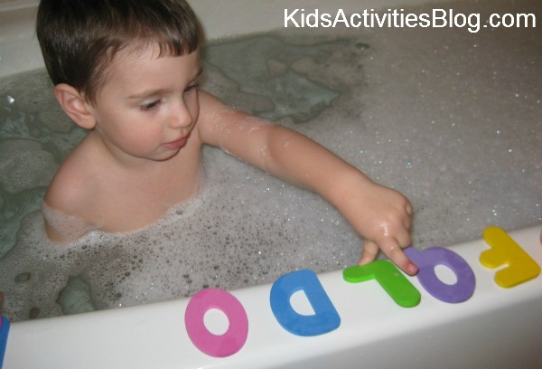 boy in bath with letters