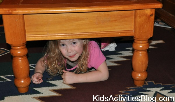 girl under table