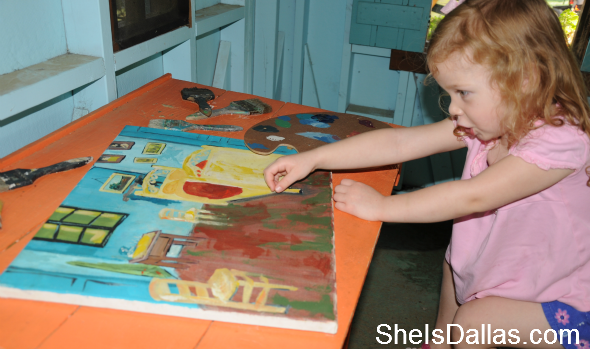 little girl at painting
