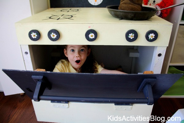 little girl in pretend oven