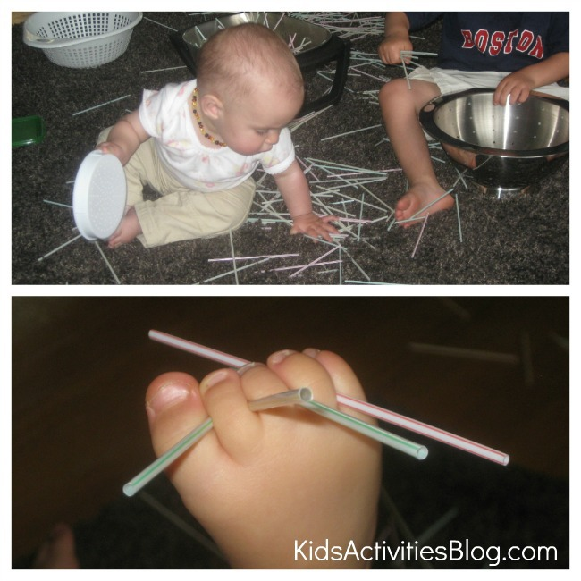 baby plays with coffee stirrers